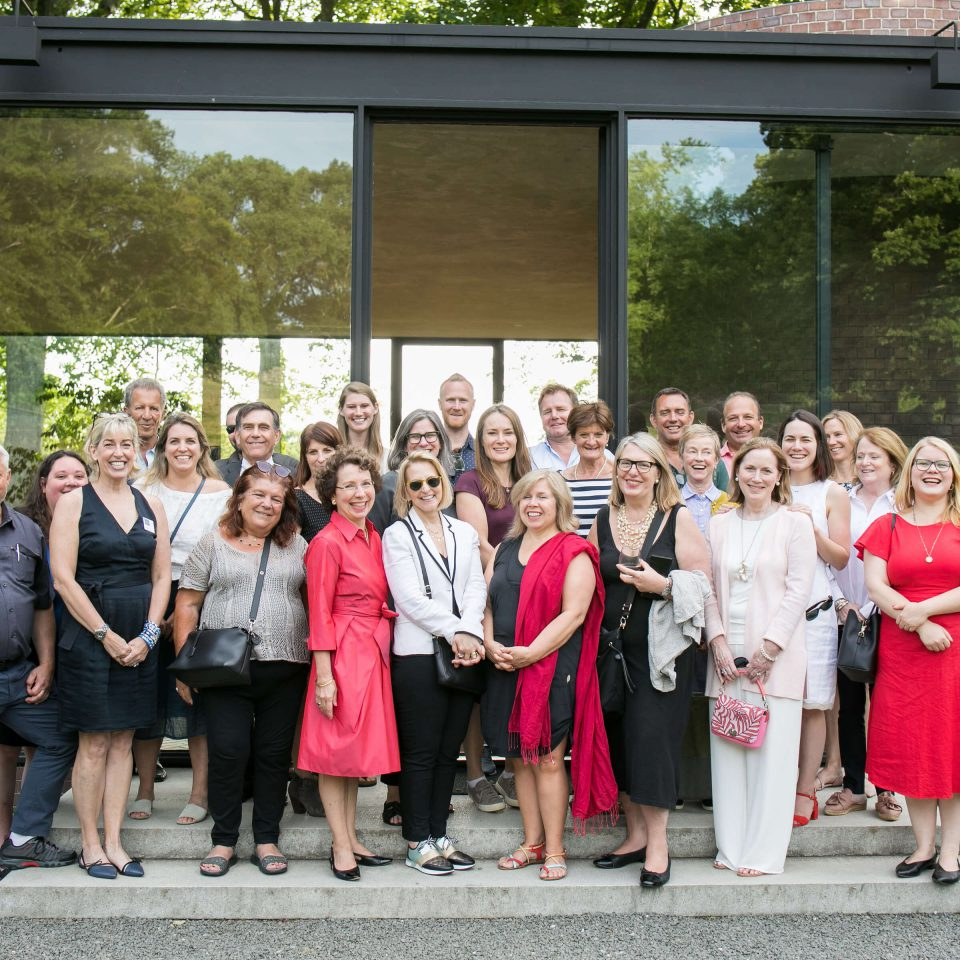 Who we are: INTO Team of trustees staff and supporters at the Glass House in New York state, USA