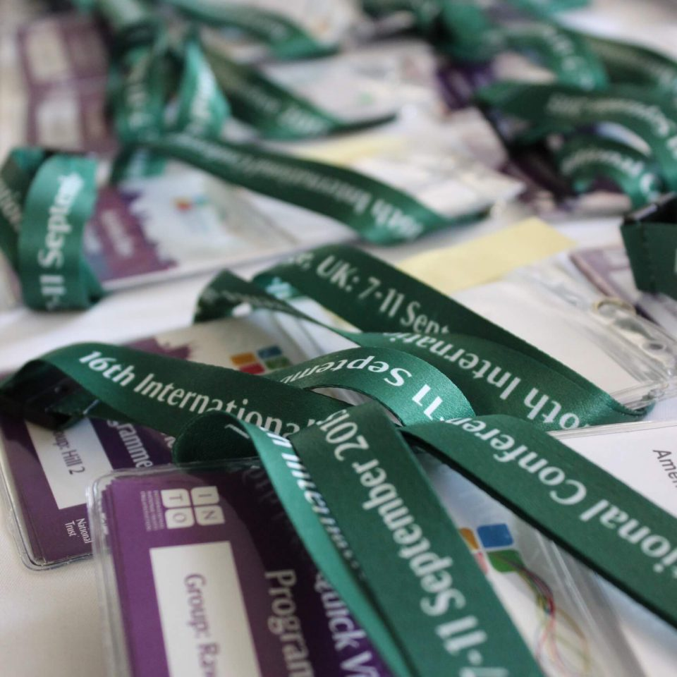 Conference badges at INTO Cambridge 2015