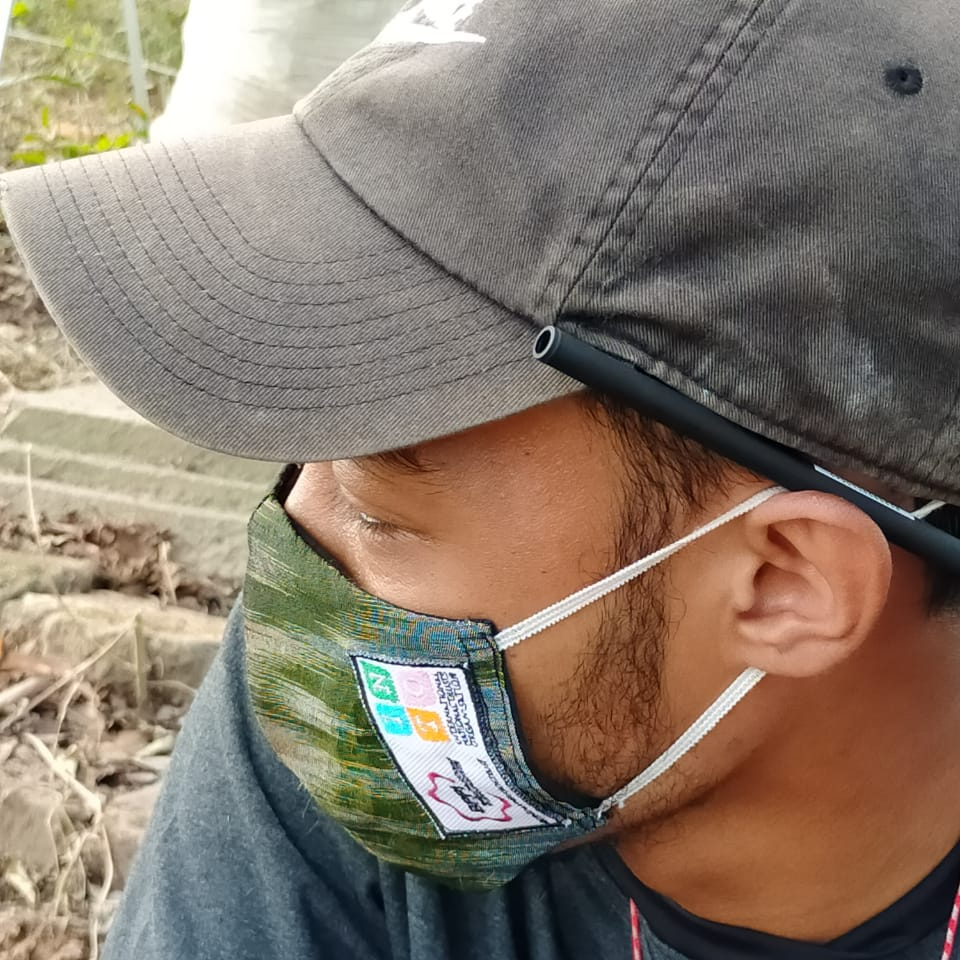 Conservation worker in Indonesia uses a mask provided by a TAP-INTO covid grant