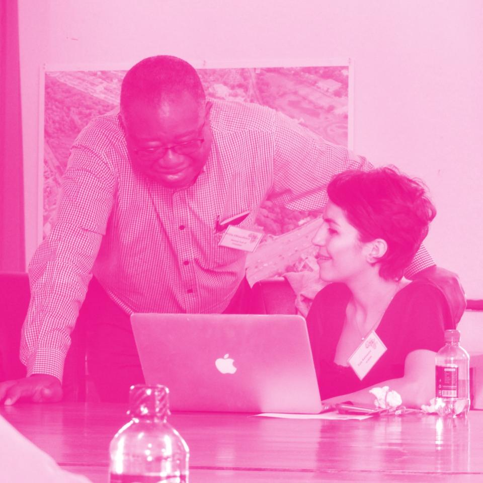 INTO Online Delegates in conversation around laptop
